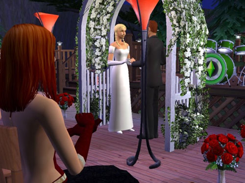 Sally looks on as the father of her children gets married.