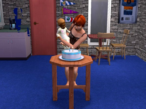 Gina helps Gabriel blow out the candles